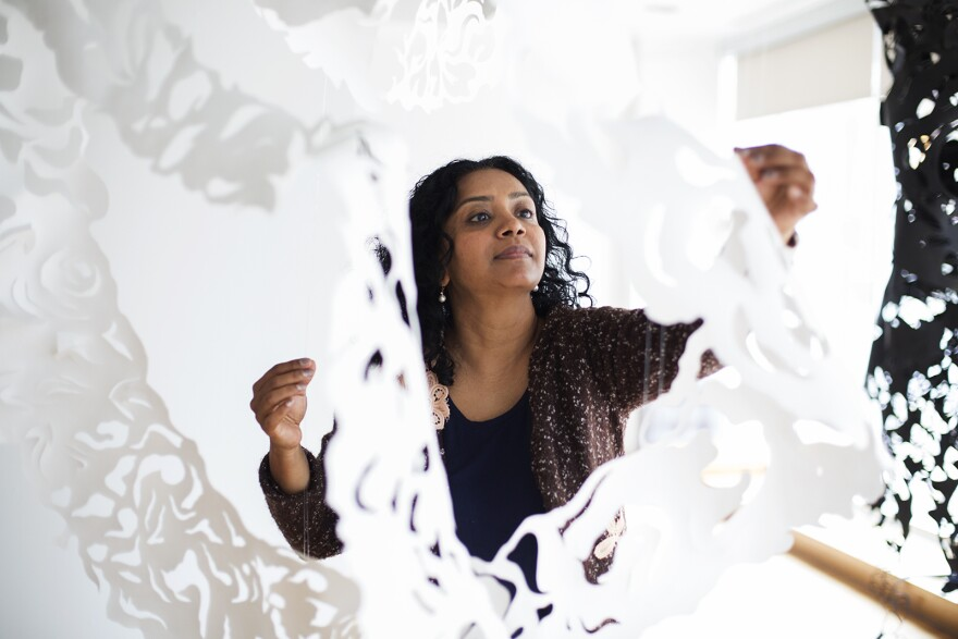 Sukanya Mani prepares her installation at the Kranzberg Arts Center on Nov. 21, 2019.