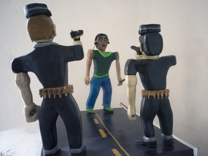 Herrera's latest work in progress represents the police shooting of a local teen.