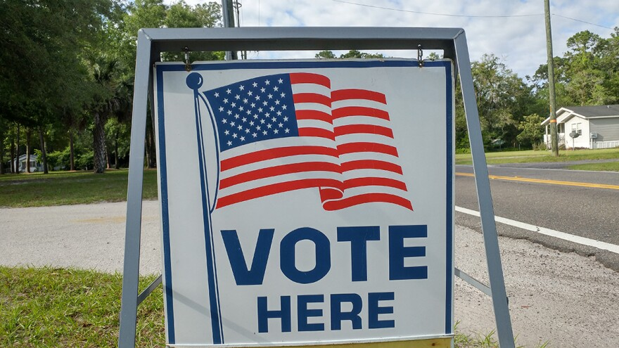 A sign directing people to a Jacksonville voting precinct is pictured.