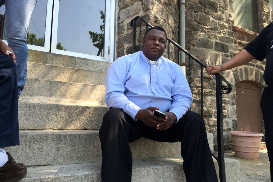 Pastor Rodney Hudson sits on the steps of Ames Memorial United Methodist Church in West Baltimore, blocks away from the center of the protests and rioting that occurred last month.