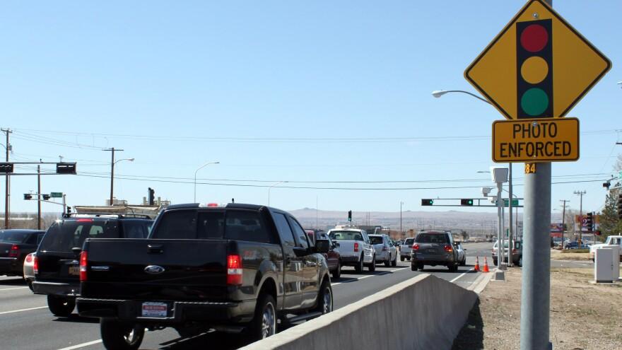 "Traffic engineers face ""a new conundrum"" in dealing with red-light cameras such as this one in New Mexico, according to a recent study looking at how cameras are operated and the perception that they are used to generate revenue."