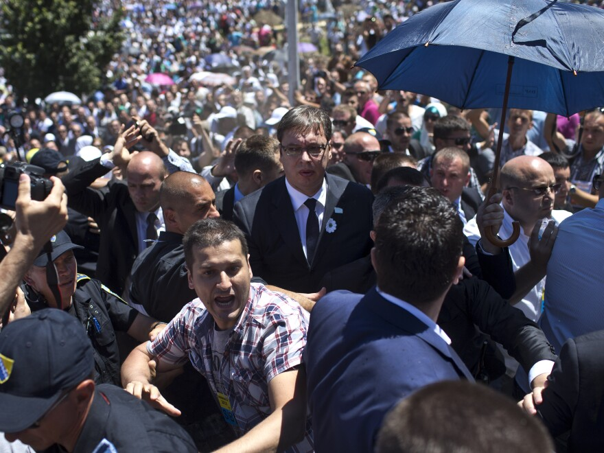 Aleksandar Vucic, Serbia's prime minister, center, is seen during a scuffle at the Potocari memorial complex near Srebrenica, Bosnia and Herzegovina, on Saturday. Vucic was attending a ceremony to mark two decades since the massacre of 8,000 Bosnian Muslim men and boys by Bosnian Serbs.