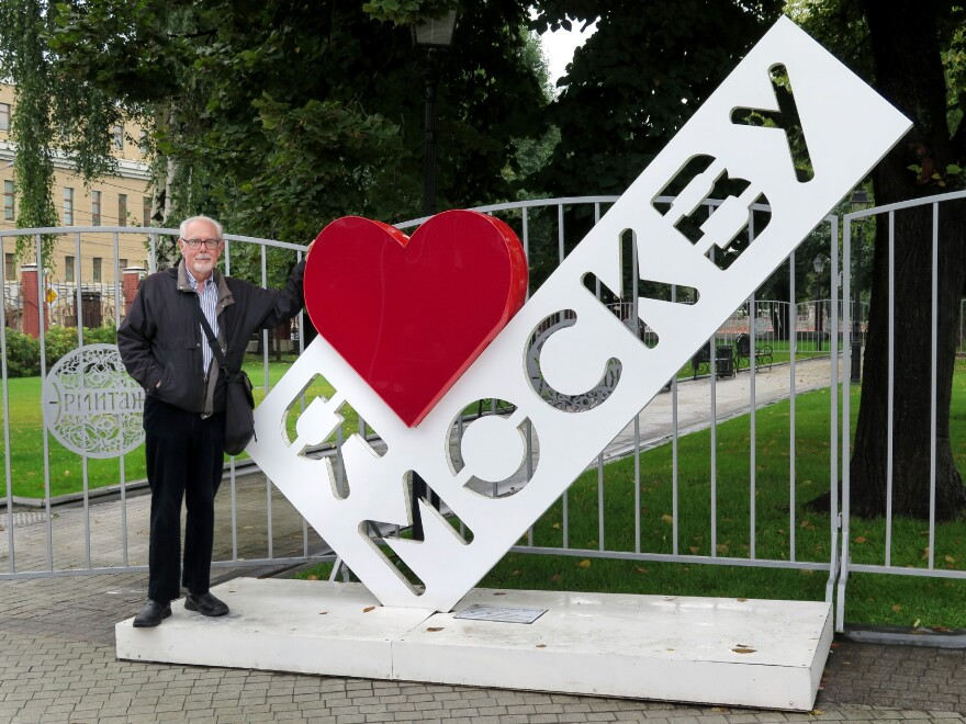 """Corey Flintoff stands by an """"I Heart Moscow"""" statue after his Russian visa was renewed for another year."""