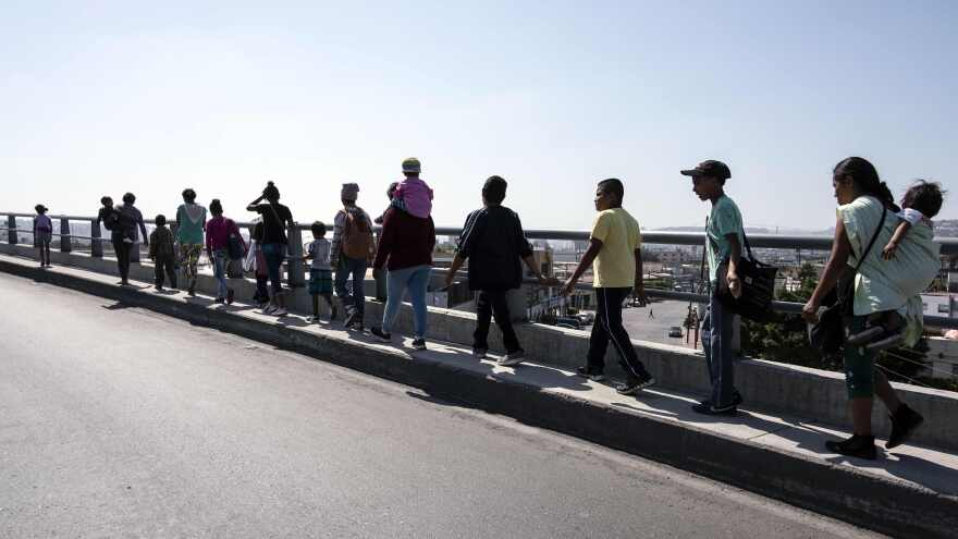 Central American migrants traveling in the Migrant Via Crucis caravan walk to their legal counselling meeting in Tijuana, Baja California state, Mexico, in April.
