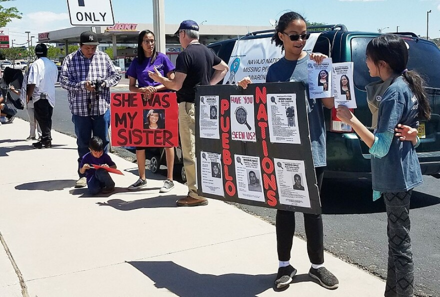Photo of people holding posters of missing Navajo people.
