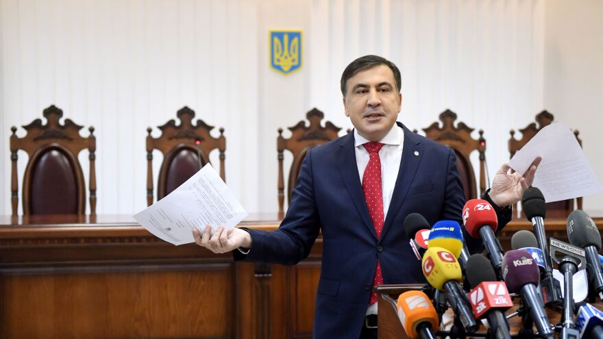 Former Georgian President Mikheil Saakashvili speaks to the media prior to a scheduled court hearing in Kiev last month.