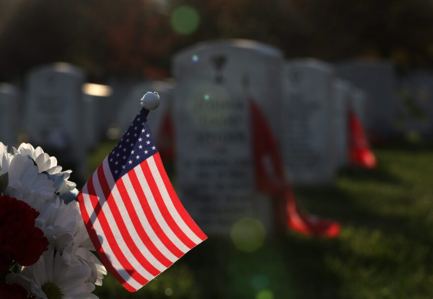 An American flag adorns a grave site at Section 60 at Arlington National Cemetery on Veterans Day Nov. 11, 2019 in Arlington, Virginia. Americans observed Veterans Day to honor those who had served in the U.S. military. (Alex Wong/Getty Images)