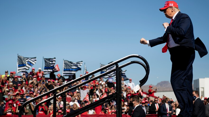 Trump dances as he leaves the stage during a rally in Bullhead City, Ariz., on Oct. 28.