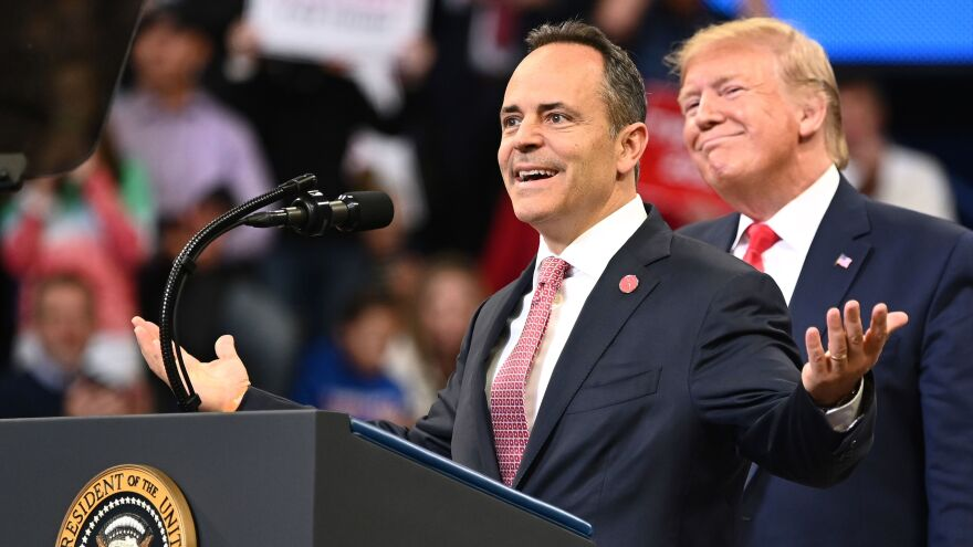 President Trump smiles behind Kentucky Gov. Matt Bevin during a rally at Rupp Arena in Lexington, Ky., on Nov. 4. Both Trump and Bevin have made unsubstantiated claims about election fraud.