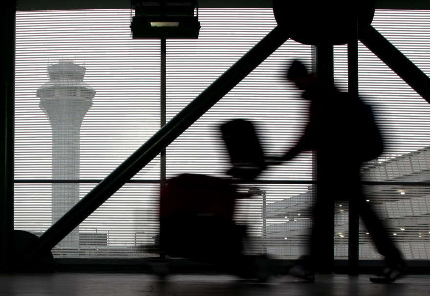 A traveler walks through Terminal 3 at O'Hare International Airport in Chicago on Saturday.