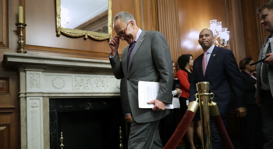 Senate Minority Leader Charles Schumer, D-N.Y., arrives for a news conference about President Trump's 100 Days at the U.S. Capitol on Friday. The Senate passed a short-term spending bill on Friday to avert a government shutdown that would have coincided with the marker.