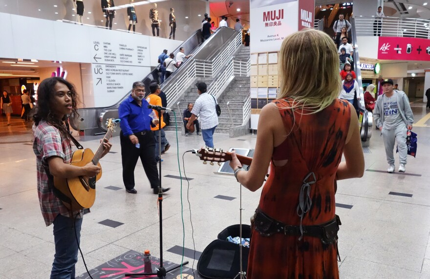 Ali Hakim performs in the main train station under Kuala Lumpur's most famous landmark, the Petronas Twin Towers. Malaysia's Tourism Ministry now provides support for buskers.
