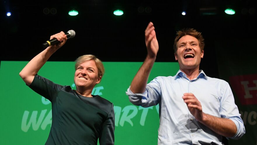 Top candidates of the Green party in Bavaria, Katharina Schulze and Ludwig Hartmann, celebrate with supporters at an election party Sunday in Munich.