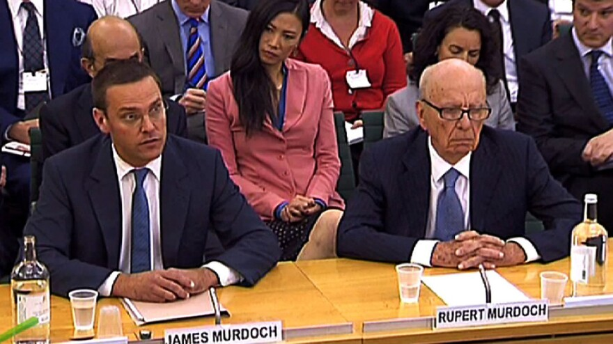 """News Corp. Chief Executive Rupert Murdoch (right), testifying alongside his son James, said his appearance before a British parliamentary inquiry in London was """"the most humble day of my life."""""""