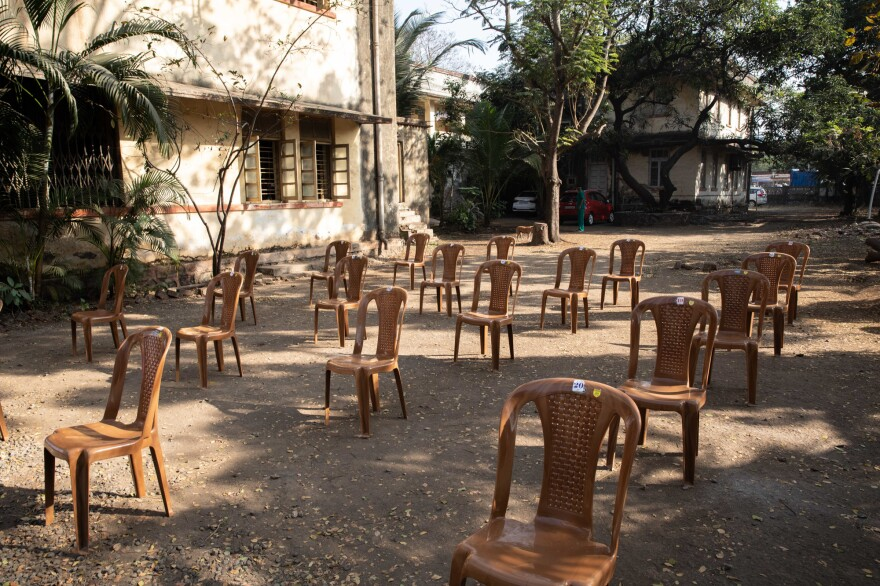 The Palghar Rural Hospital has chairs lined up — at a safe distance — for vaccine patients. But so far there are more chairs than vaccine candidates.