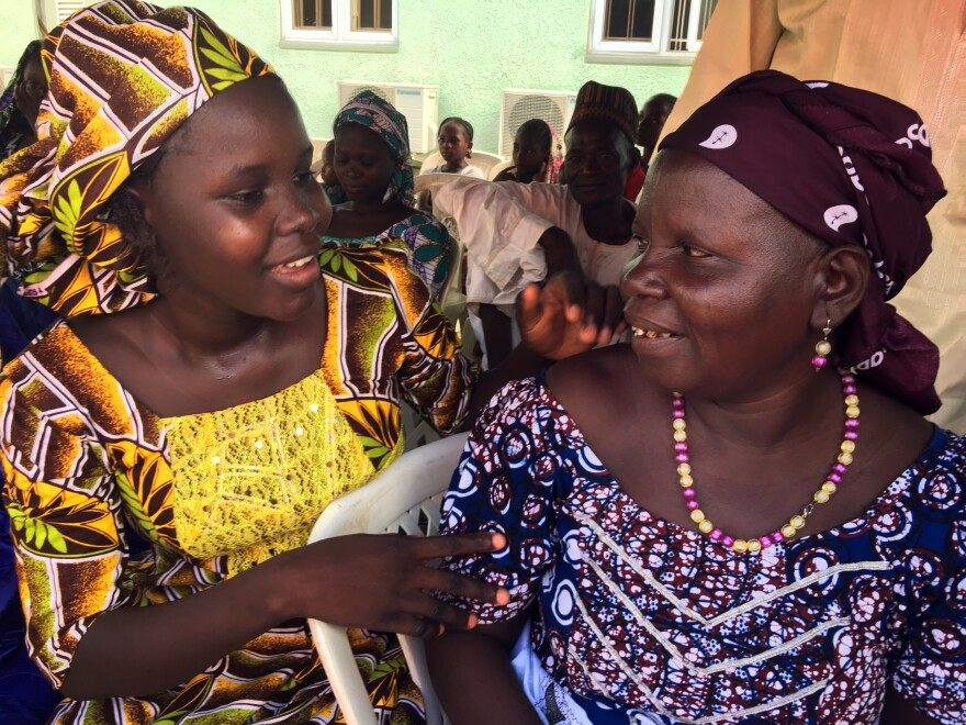 Awa Yirma (left) sobbed hysterically when her parents didn't show up on time. She was afraid they had died. It turned out they were late because their vehicle had broken down. And there was an ecstatic mother-daughter reunion.
