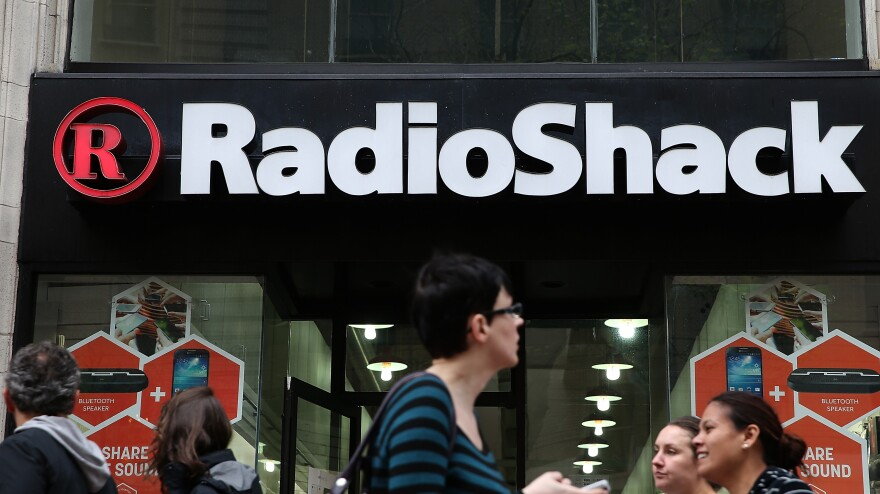 People walk by a Radio Shack storefront on Tuesday in San Francisco.