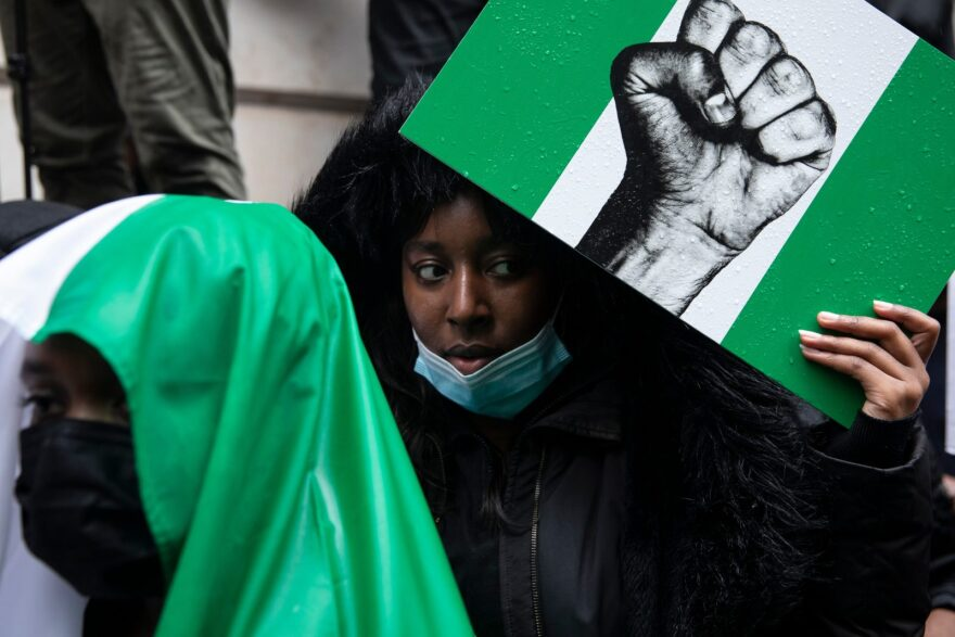 Protesters hold placards and signs calling for the end of police killings of the public in Nigeria, during a demonstration in London, England.