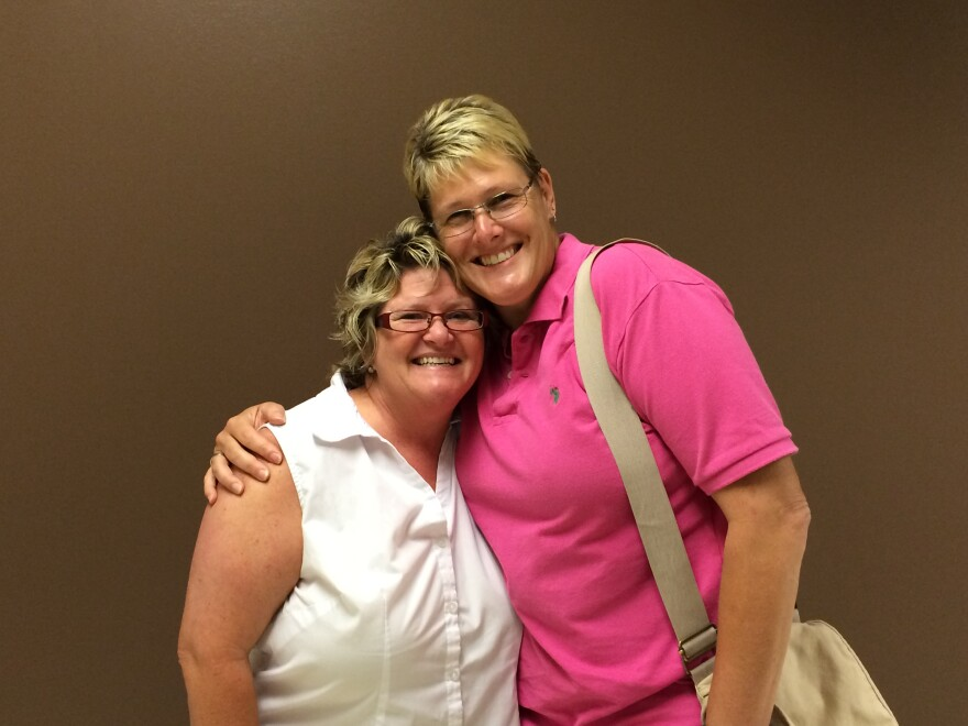 Judy Lambright (left) and Danielle Van Brackel (right) were among the first couples in Montgomery County to get a marriage license following the U.S. Supreme Court's decision Friday.