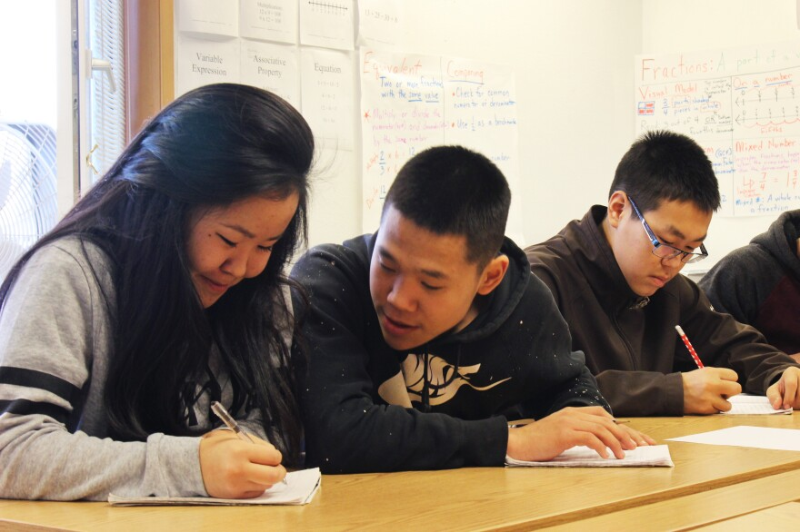 Rosie Matthias, Byron John, and Pedro Active, ninth graders in a Yup'ik language class at the Newtok School. Residents worry they will lose their language and culture if they are forced to scatter as their land erodes.