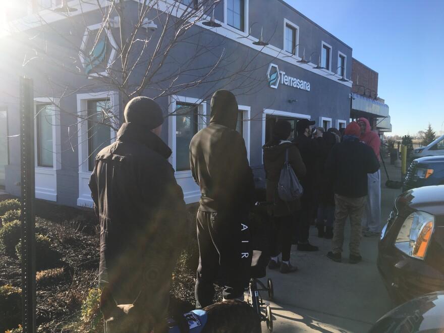 a photo of people waiting to recieve medical marijuana at a dispensary.