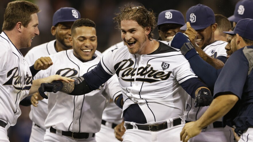 """Yasmani Grandal is swarmed by teammates after hitting a walk-off single to beat the Los Angeles Dodgers on Friday. But commentator Frank Deford wonders why """"walk-off"""" has become such a ubiquitous term."""