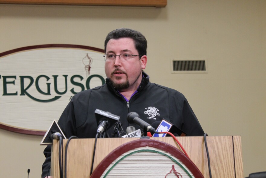 Ferguson Mayor James Knowles III meets the press on Wednesday. He announced Police Chief Tom Jackson was stepping aside.