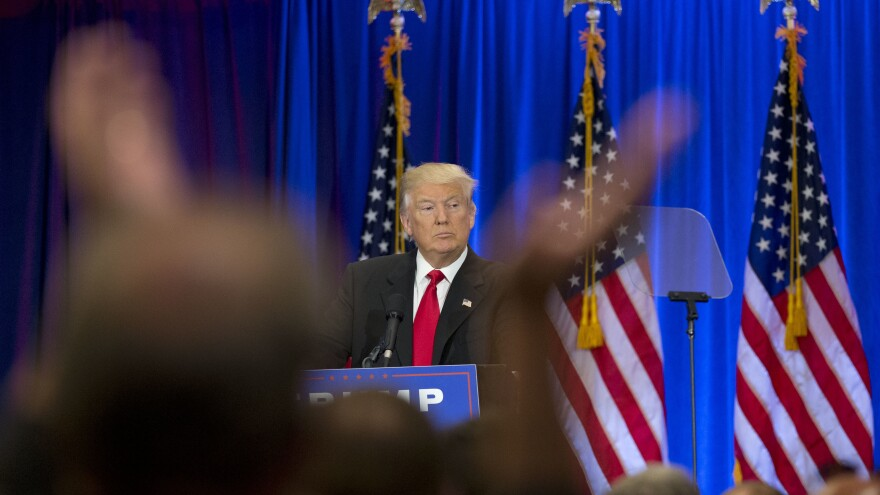 A supporter claps as Republican presidential candidate Donald Trump speaks in New York on Wednesday.