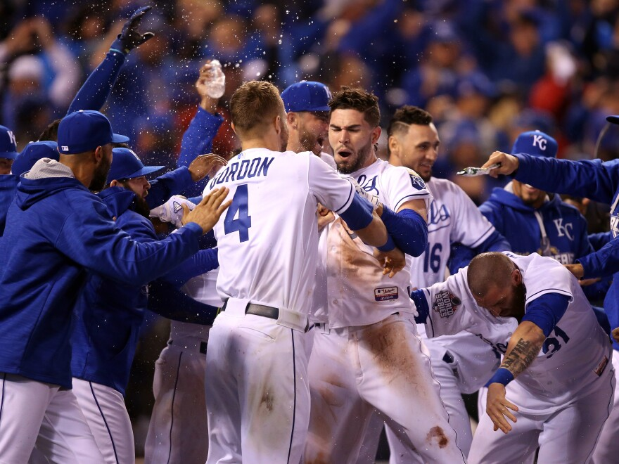 Alex Gordon and Eric Hosmer (center) of the Kansas City Royals celebrate defeating the New York Mets 5-4 in Game One of the 2015 World Series Tuesday night.