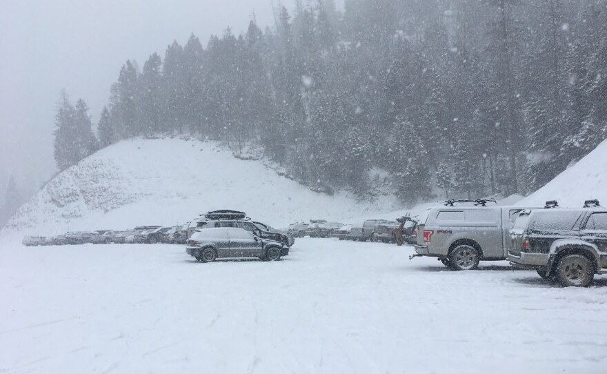 Cars fill a parking lot at Snowbowl mountain April 01,2020. Guidelines for safe recreation during the coronavirus pandemic include social distancing and toning down the risks in order to protect first responders and preserve hospital beds.