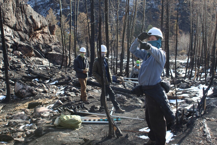 Colorado State University hydrologist Stephanie Kampf and a team of research assistants assess the Cameron Peak burn scar to place a weather station.