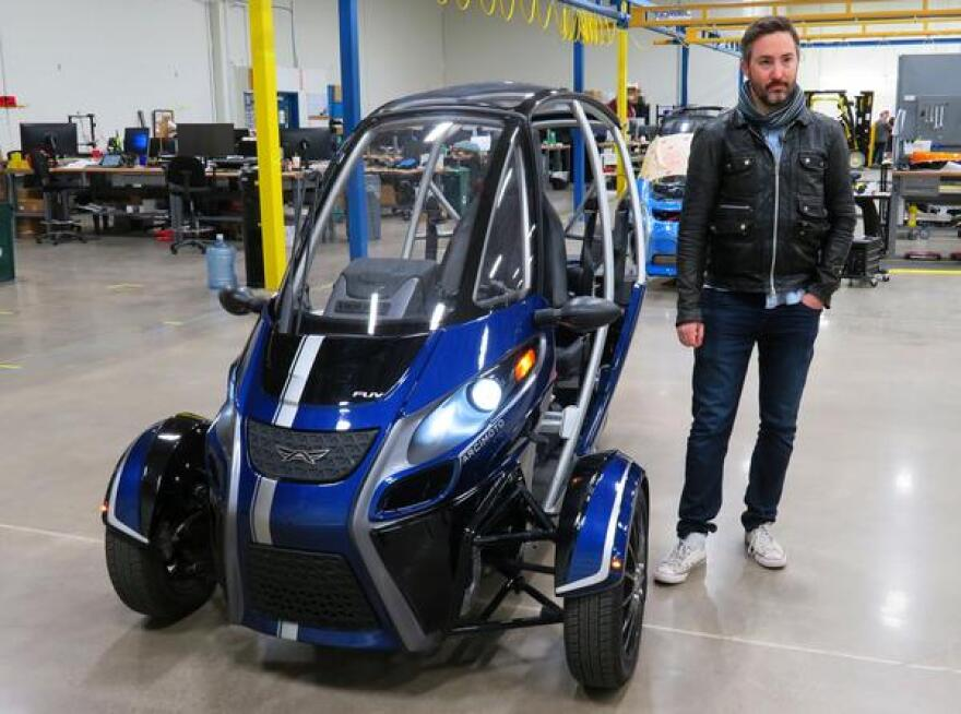 Arcimoto's Creative Director, Jeremy Bronson, with one of the latest EVs his company makes.