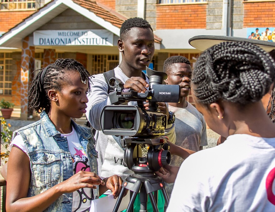 Maxwell Odhiambo (center, holding camera) had one week to make a movie.