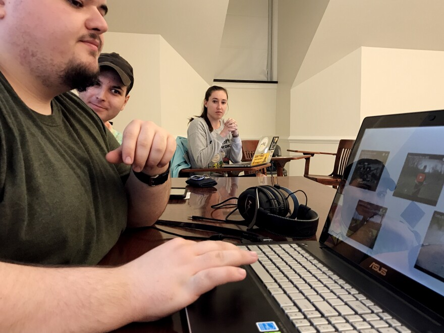 "Kyle Schmitt (from left), Owen Uber and Jordan Riger watch videos of firearm demonstrations at a meeting of Students for the Second Amendment. According to its website, the student group wants to ""erase the negativity associated with firearms"" at the University of Delaware."