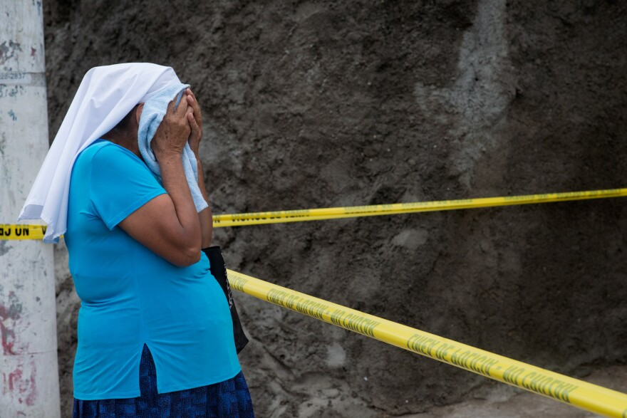 Marcela's grandmother cries at the scene of her granddaughter's death.
