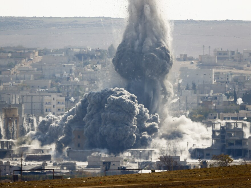 An explosion following an airstrike is seen in the Syrian town of Kobani from near the Mursitpinar border crossing in the southeastern town of Suruc, in Turkey's Sanliurfa province, on Wednesday.