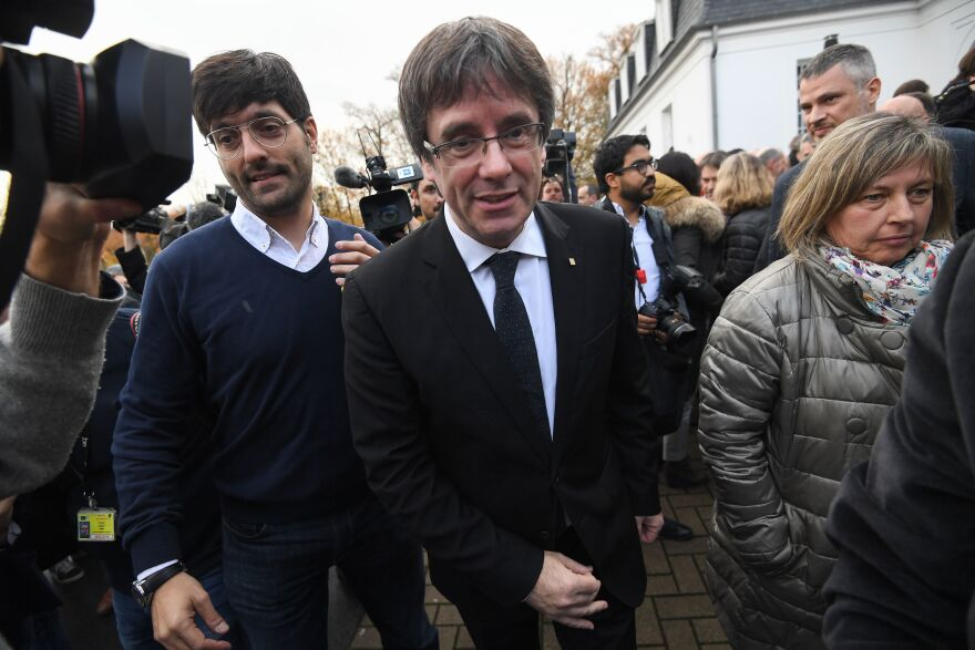 Ousted Catalan leader Carles Puigdemont (center) is seen in Belgium last month, where he has been living in exile since October. On Tuesday, a Spanish judge withdrew the international warrant for Puigdemont's arrest.