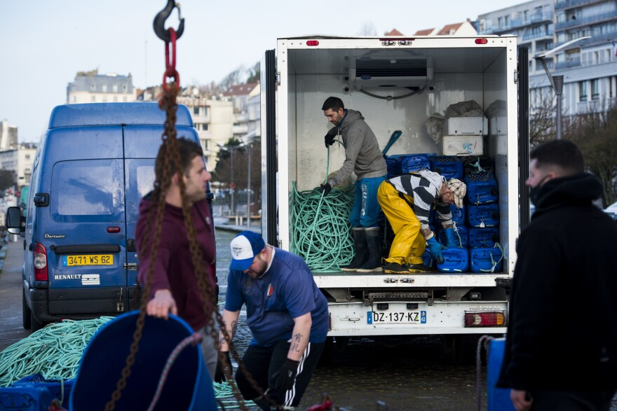 "Crew from the fishing boat <em>L'Ophelea</em> unload equipment in Boulogne-sur-Mer. Brexit supporters have equated fishing rights with British sovereignty and claimed Europeans were ""stealing"" their fish."