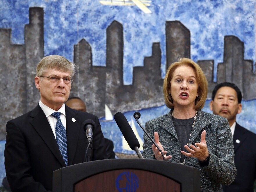 Seattle City Attorney Pete Holmes (left) looks as Mayor Jenny Durkan (right) announces on Thursday the city's intention to vacate misdemeanor marijuana possession convictions.