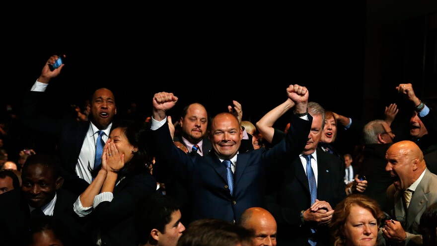 The delegation of the International Federation of Associated Wrestling Styles celebrates as its sport is voted to be included in the 2020 and 2024 Summer Olympic Games.