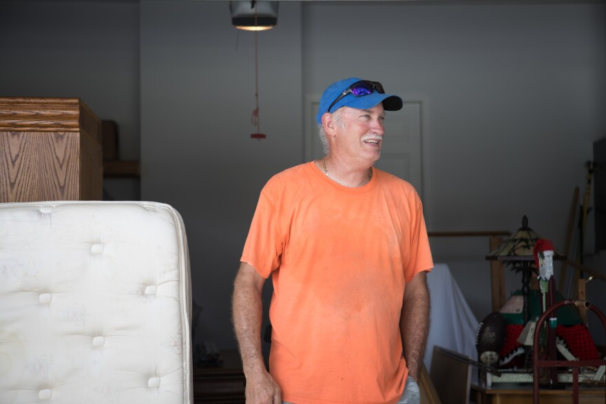 Tim Huffstutler moves furniture from his late mother's home and into another that sits at a higher elevation. He and his family planned to ride out the storm despite a mandatory evacuation order in Bradenton, Fla.