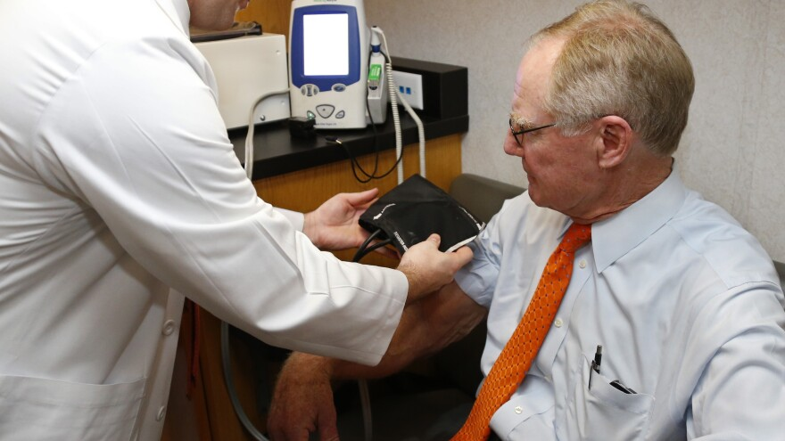Oklahoma State University President Burns Hargis gets his blood pressure checked in a mobile medical unit parked at the state Capitol.