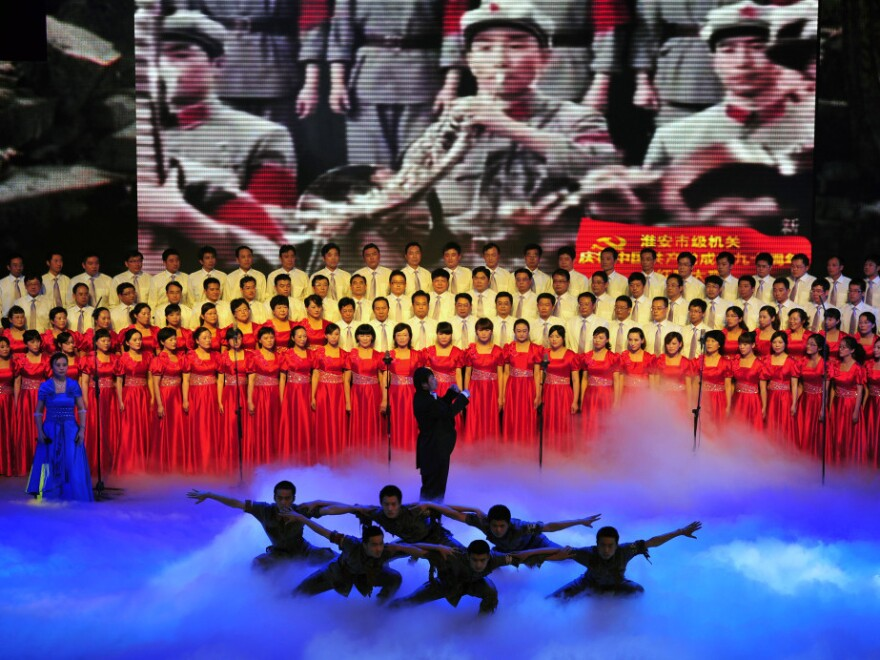 """Officers from Huaian city perform patriotic """"red songs"""" at the Huaian Great Hall of the People to mark the 90th anniversary of the founding of the Communist Party of China."""