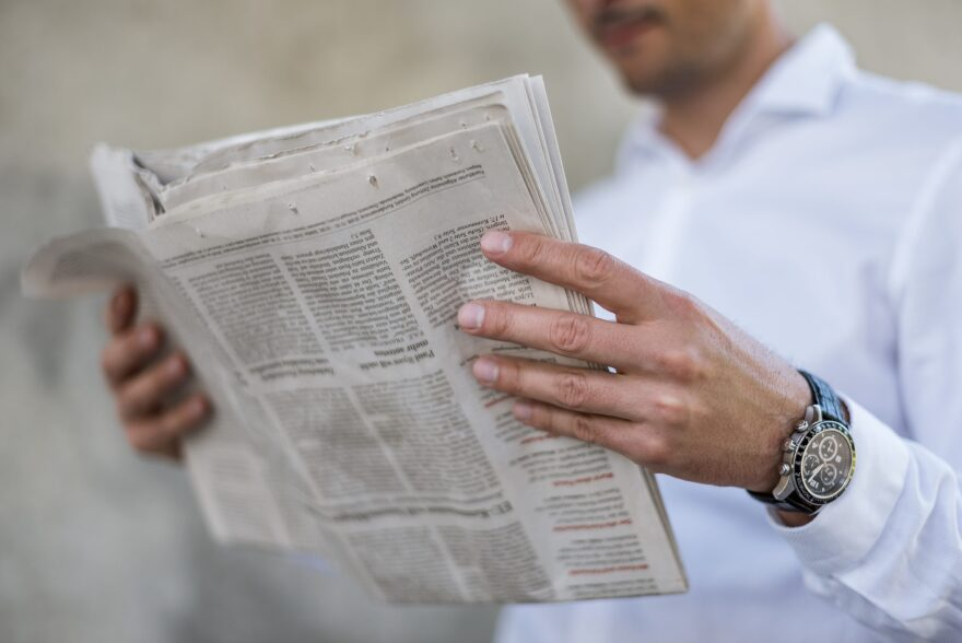 A man reads a newspaper. (Getty Images)