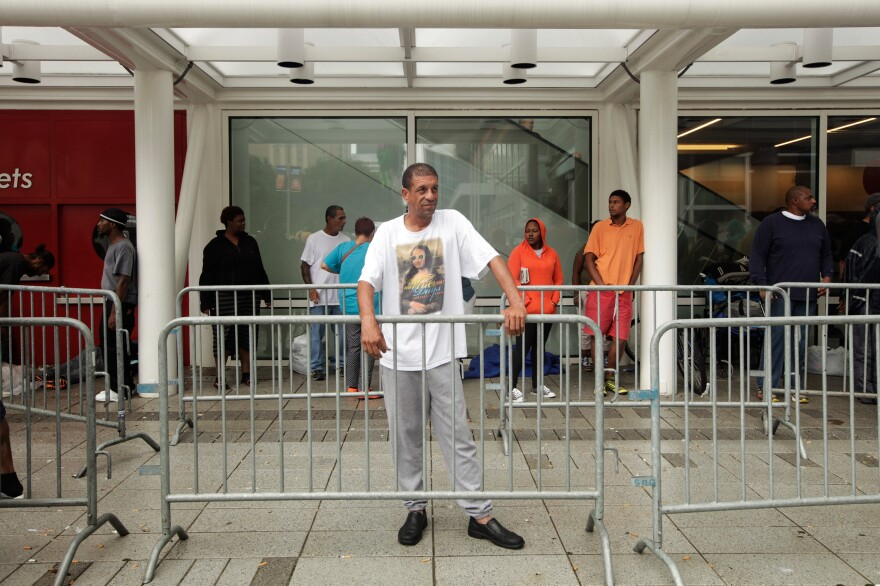 """Joseph Guilroy, a server at IHOP, got to the convention center via a city dump truck that took him to a transit center and then he got on a bus. """"My apartment is done. It's been hell. This is my city, I been here all my life. We are gonna get through it though. We always do."""""""