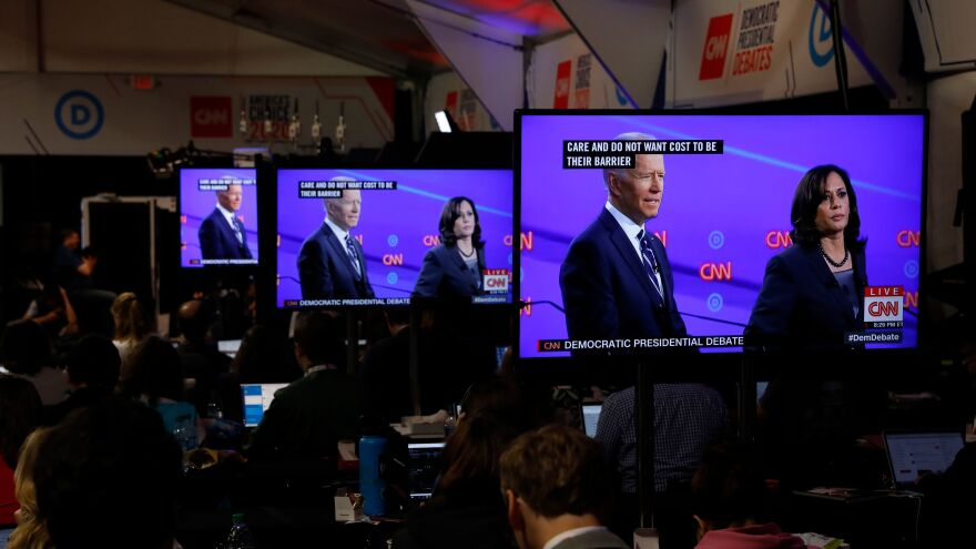 Vice President Joe Biden and Sen. Kamala Harris, D-Calif., as seen on televisions in the press room during the Democratic primary debate in Detroit, Mich.