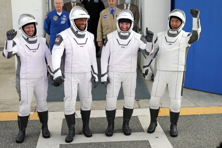 NASA astronauts, from left, Shannon Walker, Victor Glover, and Michael Hopkins and Japan Aerospace Exploration Agency astronaut Soichi Noguchi leave the Operations and Checkout Building on their way to launch pad 39A for the SpaceX Crew-1 mission to the International Space Station at the Kennedy Space Center in Cape Canaveral, Fla., Sunday, Nov. 15, 2020. (John Raoux/AP)