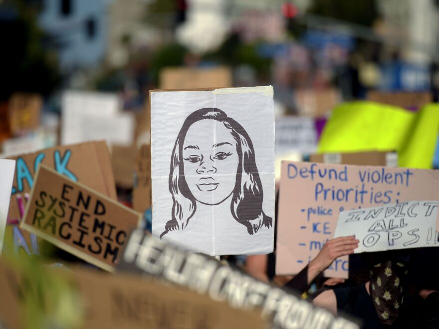 Protesters march with placards and a portrait of Breonna Taylor during a demonstration against racism and police brutality this month in Hollywood, Calif. The mayor of Louisville, Ky., has announced that an officer involved in her death will be fired.