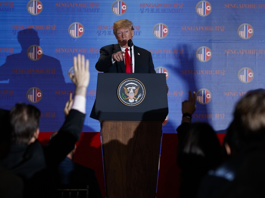President Trump speaks during a news conference Tuesday after meeting with North Korean leader Kim Jong Un on Sentosa Island in Singapore.