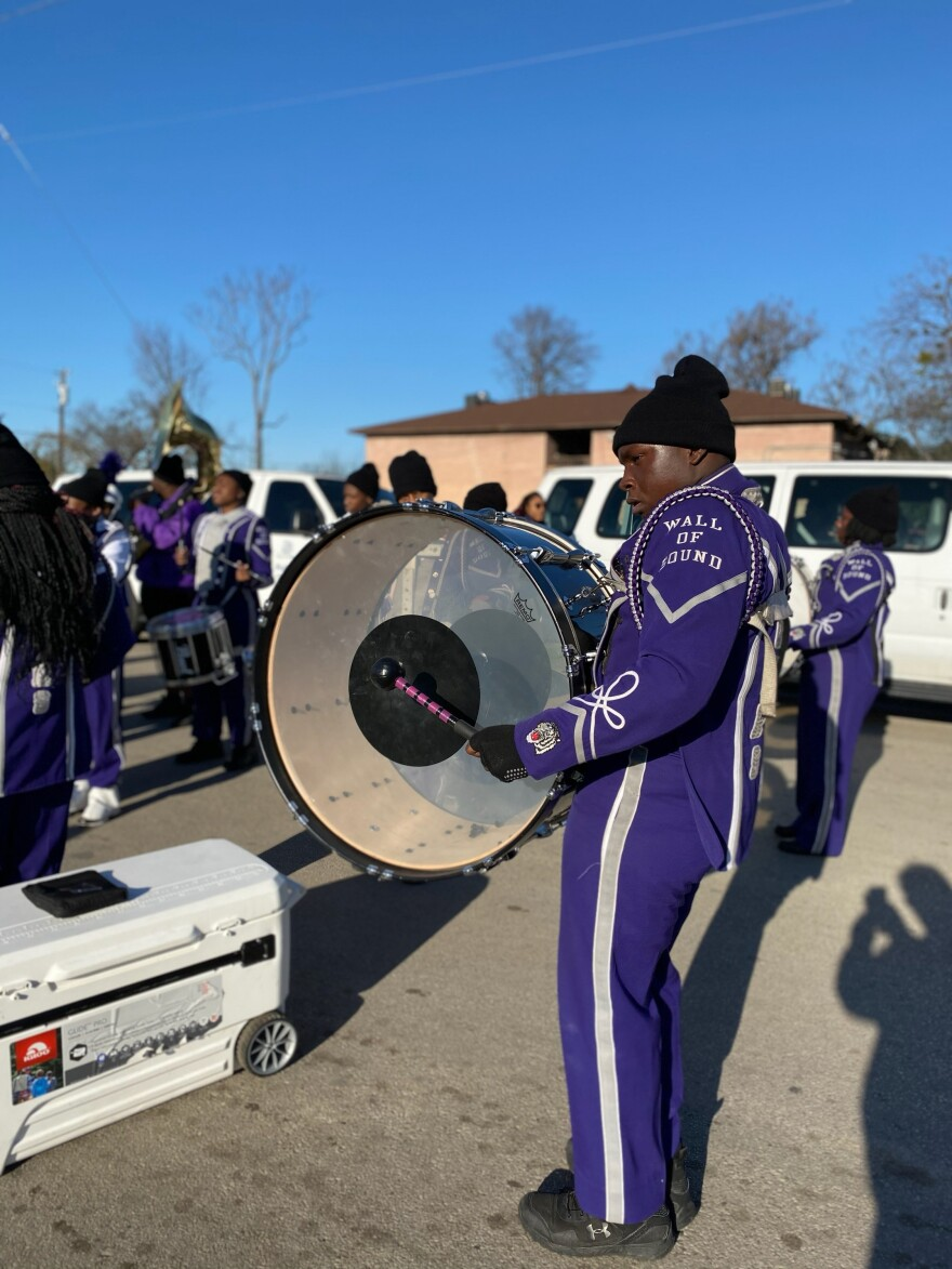 """A member of the """"Wall of Sound"""" marching band at Lincoln High School prepares for the parade."""